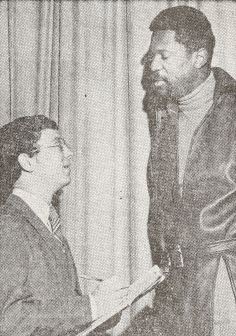 """Original caption from 1970 """"How Tall?"""" - That's what ex-Boston Celtic great Bill Russell appears to be asking Herald-News sportswriter Joe Perrone. The two met yesterday when Russell gave a talk at the Rutherford campus of Fairleigh Dickinson University."""